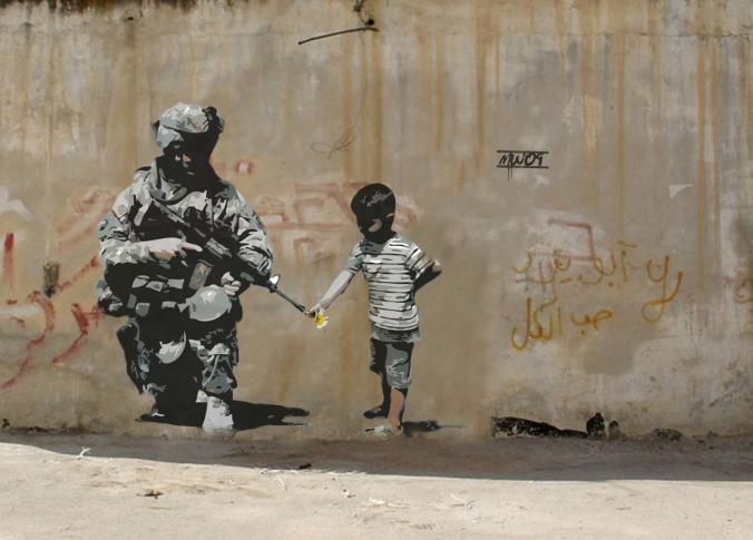 بانكسي - طفل و جندي
